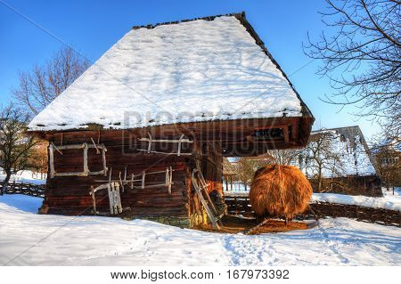 Traditional house stable of the village museum from Baia Mare, in winter season
