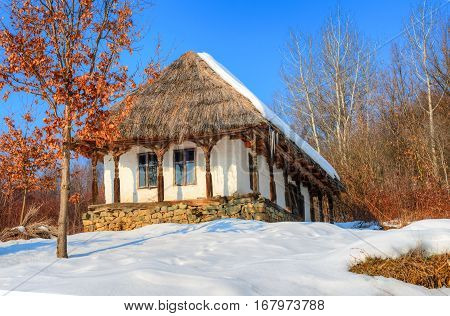 Traditional wooden house of the village museum from Baia Mare, place of Transylvania - Romania - in winter season