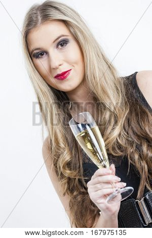 portrait of young woman with a glass of champagne
