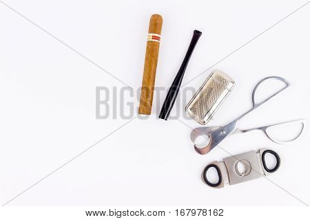 Object Photography Of A Cigar,a  Lighter, A Cigarette Holder And Metal Cutters
