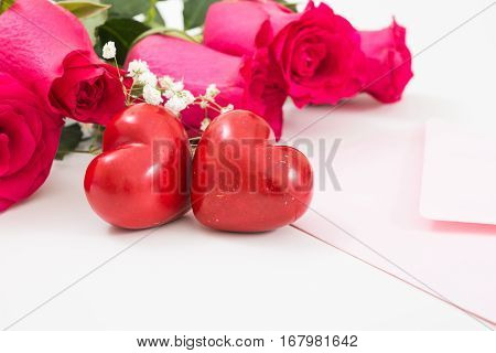 Two Red Hearts With Pink Envelope And Red Roses Closeup.