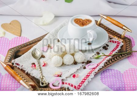 Breakfast in bed on copper tray over bed linens