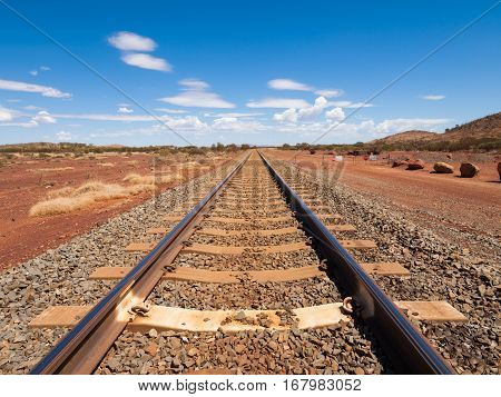 Australia Northern territory 05/21/2014 Outback railroad crossing disappearing into the horizon.