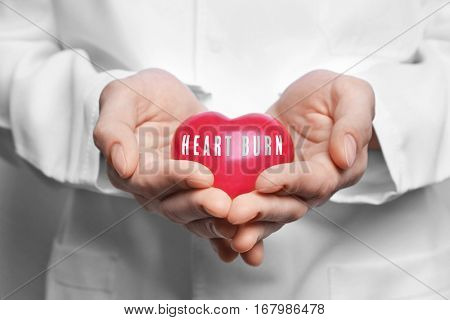 Cardiology and health care concept. Doctor's hands holding heart