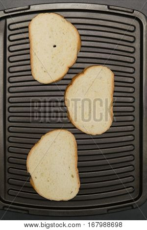 three slices of white bread is grilled