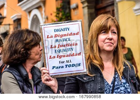 Antigua, Guatemala - January 21 2017: Woman holds sign in peaceful Women's March as part of global protest protecting women's rights & other causes