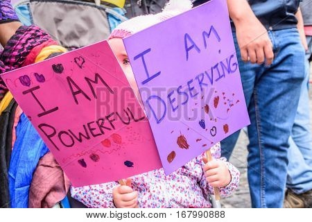 Antigua, Guatemala - January 21 2017: Girl holds signs in peaceful Women's March as part of global protest protecting women's rights & other causes