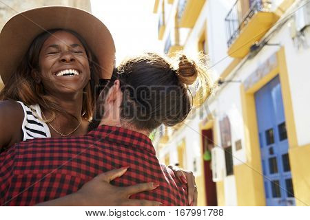 Happy couple embracing on vacation, close up, eyes closed