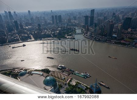 SHANGHAI CHINA - AUGUST 29 2016: Aerial view of Shanghai Bund district and the Huangpu river in Shanghai China on August 29 2016.