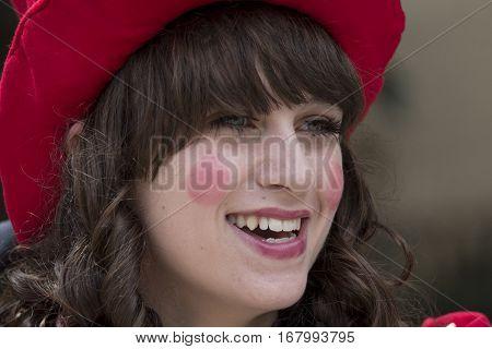 CAGLIARI, ITALY - June 1, 2014: Sunday at La Grande Jatte public gardens - Sardinia - portrait of a beautiful smiling girl in Victorian costumes