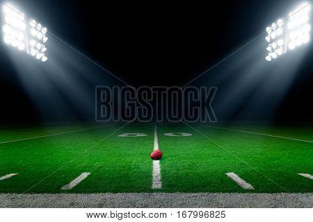 American football stadium background illuminated by lights