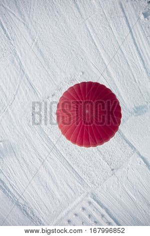 Hot air balloon landing view from top during winter in Cappadocia