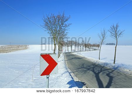 Country road in the Ore Mountains in winter Saxony Germany