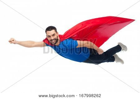 freedom, power, motion and people concept - happy man in red superhero cape flying in air