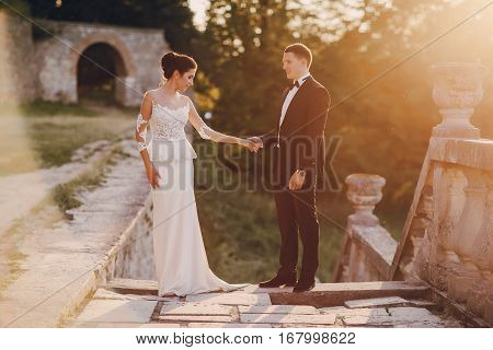 bride and groom standing at sunset HD