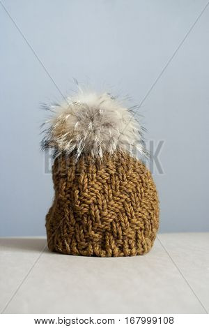 Yellow Winter knitted cap sand-colored fur pompon