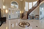 Stunning two story entry foyer with lots of space boasts marble mosaic tile floor front door framed with arch window and sidelights grand staircase with glossy wood curved banister. Northwest USA poster