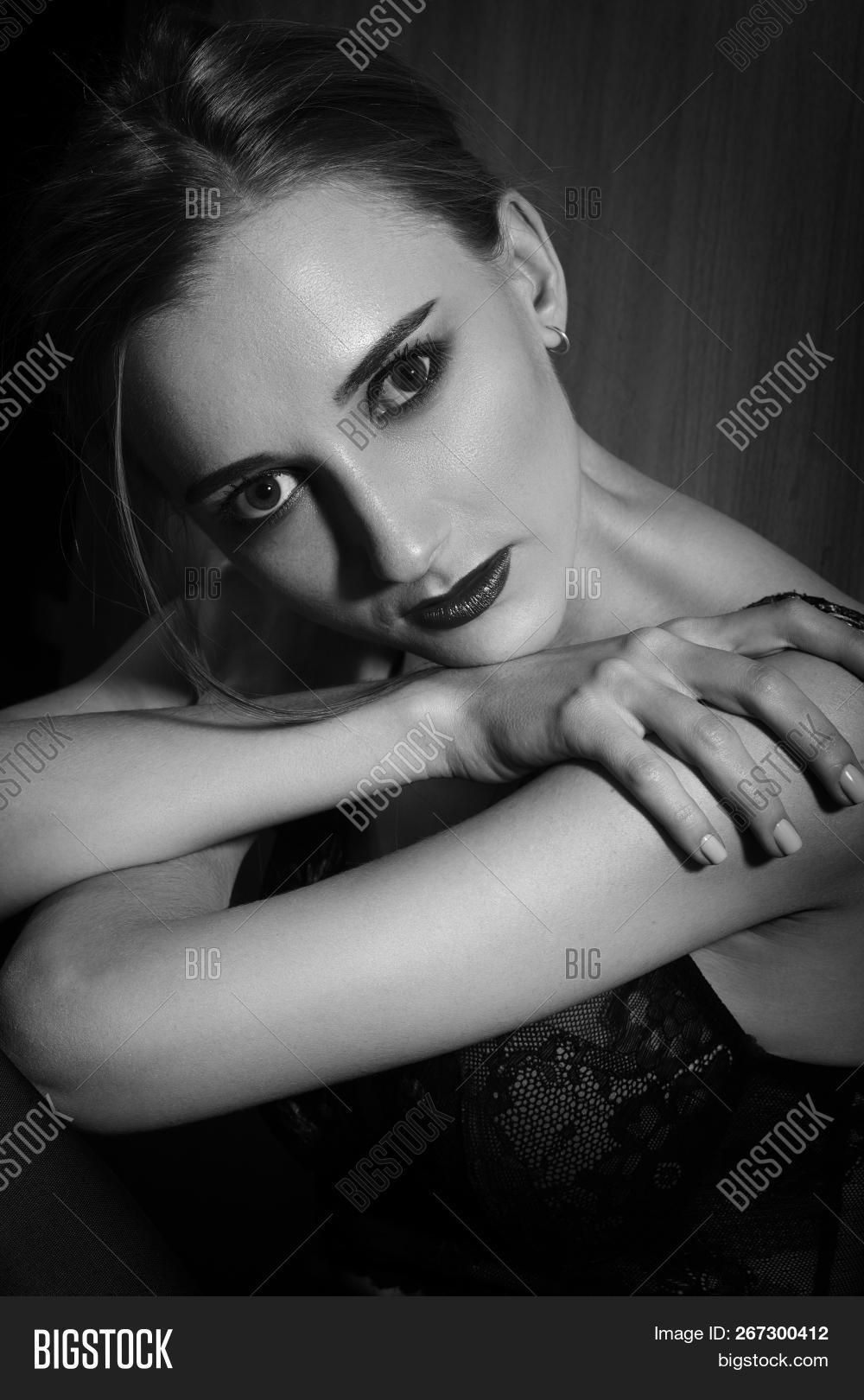 c9ace5b62 Sad Beautiful Young Woman In Lingerie Looking At Camera In Dark