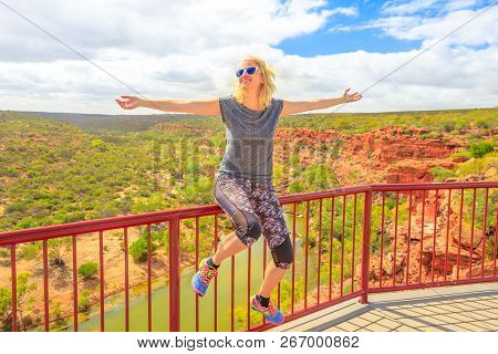 Blonde Caucasian Woman With Open Arms Enjoys The Murchison River Gorge Views From Hawks Head Lookout