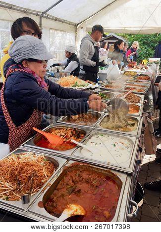 Waterloo, Belgium - November 4, 2018: Thai Street Food. Vendors Prepare And Serve Authentic Thai Foo