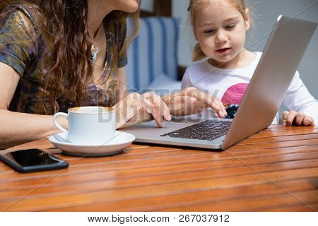 Girl Looking At Woman Hands Typing On Keyboard Laptop