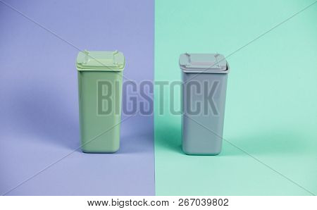 Recycling. Ecology Concept. Closed Waste Containers On Pastel Double Background