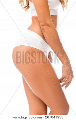 Cropped Image Of Sexy Fit Woman Wearing White Panty In Studio