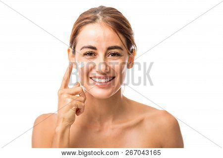 Happy Mid Adult Woman With Anti-aging Cream On Face Isolated Over White Background