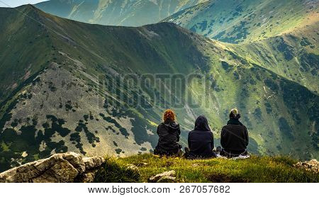 A Group Of Ladies Enjoying Lunch After A Long Hike To The Summit Of A Hill In The Polish Tatra Mount