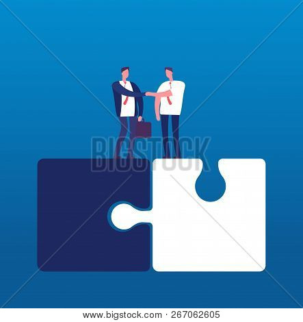 Businessmen With Puzzle. Man Handshaking On Huge Puzzles. Partnership Cooperation And Success Teamwo
