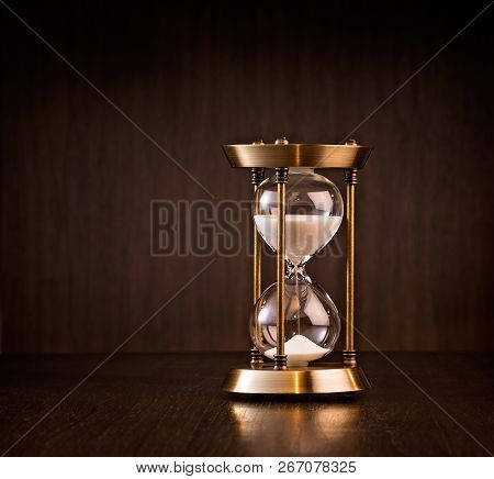 Hourglass Measuring Time Passing.  Business Deadline Or Running Out Of Time Concept.