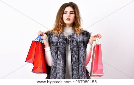 Shopping Concept. Fashionista Buy Fashionable Clothes In Shop. Girl Makeup Face Long Hairstyle Wear