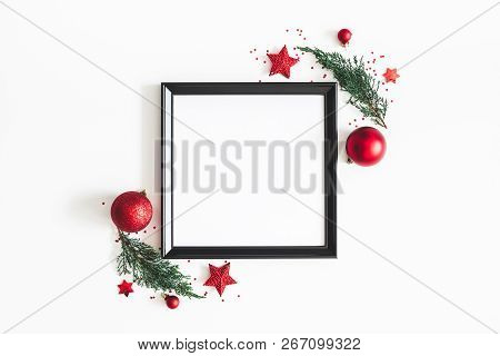 Christmas Composition. Photo Frame, Red Decorations, Fir Tree Branches On White Background. Christma