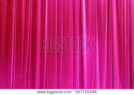 Photo Theatrical curtain of crimson color of velvet. poster