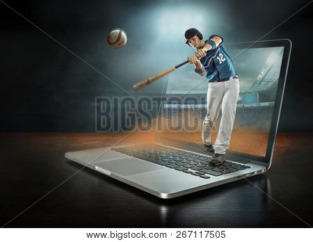 Caucassian baseball Player in dynamic action with ball in a professional sport game play in baseball , stay on the laptop under stadium lights.