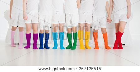 Kids Wearing Colorful Rainbow Socks. Children Footwear Collection. Variety Of Knitted Knee High Sock