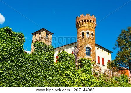 Buttrio Castle Brick Tower Seen From Outide The Perimeter Crenellated Wall Covered In Ivy, Udine, Fr
