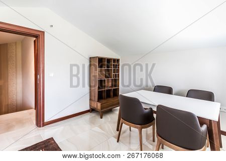 Table And Chairs For Multipurpose Use In An Attic Room