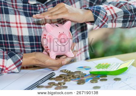 Piggy Bank Protected By Hands, Savings Protection.