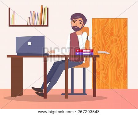 Man In Office At Workplace Typing On Computer, Bookshelf And Door Behind Him, Male Sitting At Table