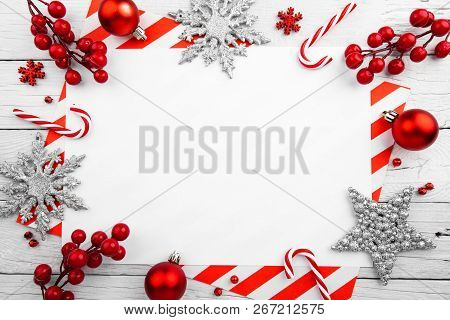 Christmas ornament made of red adornment on wooden background poster
