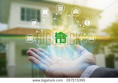 Hand Holding With Property Investment Icons Over The Network Connection On Property Background, Prop