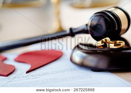 Two Broken Wedding Rings On Judge Gavel. Divorce, Separation And Family Law Concept