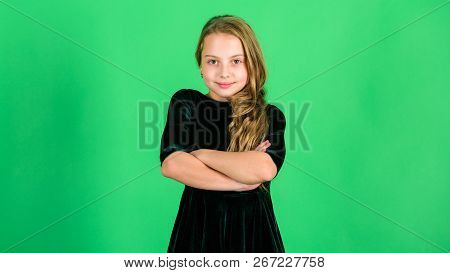 Elegant Hairstyles Concept. Little Girl Wear Dark Velvet Dress Looks Elegant And Adorable. Little Mi