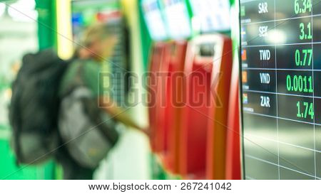 Exchange Money And Traveler Concept - Thai Bath Exchange Money Rate Board In Airport With Blurred Tr