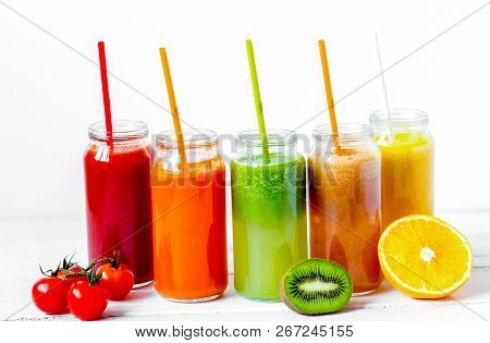 Fresh Detox Juices In Glass Bottles On White Background