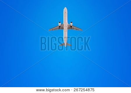 Airplane Flies Into A Perfect Blue Sky