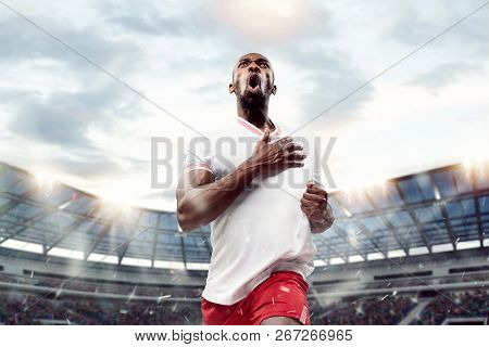 The Football African Player In Motion On The Field Of Stadium At Day. The Professional Football, Soc