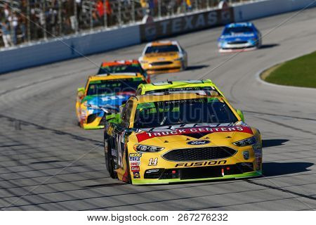 November 04, 2018 - Ft. Worth, Texas, USA: Clint Bowyer (14) battles through the turns for position during the AAA Texas 500 at Texas Motor Speedway in Ft. Worth, Texas.