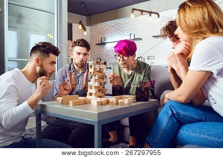 A Cheerful Group Of Friends Play Board Games.
